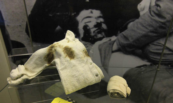 A Bandage and a baby's vest are pictured